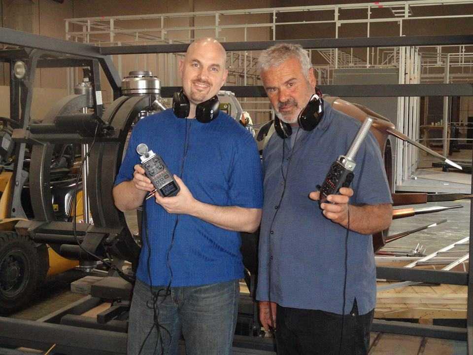 Frank and I at S.T.A.T.I.O.N in front of the frame of the Tessaract.